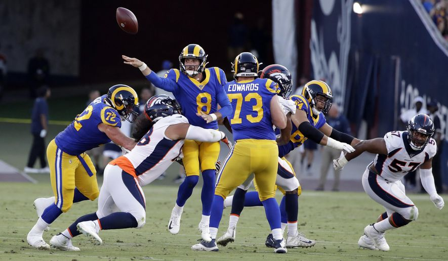 Los Angeles Rams quarterback Brandon Allen throws under pressure against the Denver Broncos during the first half of an NFL preseason football game Saturday, Aug. 24, 2019, in Los Angeles. (AP Photo/Rick Scuteri)