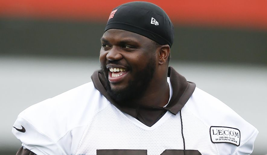 FILE - In this May 22, 2019, file photo, Cleveland Browns' Greg Robinson walks off the field during an NFL football organized team activity session at the team's training facility in Berea, Ohio. Browns starting left tackle Greg Robinson has re-signed with the team Monday, Sept. 2, 2019, a day after his contract was surprisingly terminated. (AP Photo/Ron Schwane, File)