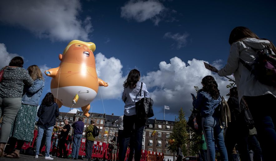 The Baby Trump balloon is seen during a protest in Copenhagen, Denmark, Monday, Sept. 2, 2019. The US president Donald Trump have canceled an scheduled state visit to Denmark on Sept. 2-3 but demonstrators carried out their protests anyway. (Mads Claus Rasmussen/Ritzau Scanpix via AP)