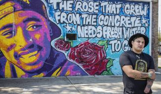 In this May 6, 2019, photo artist Chris Rodriguez, poses for a photo as he talks about his most recent mural in Toledo, Ohio. (Phillip L. Kaplan/The Blade via AP)