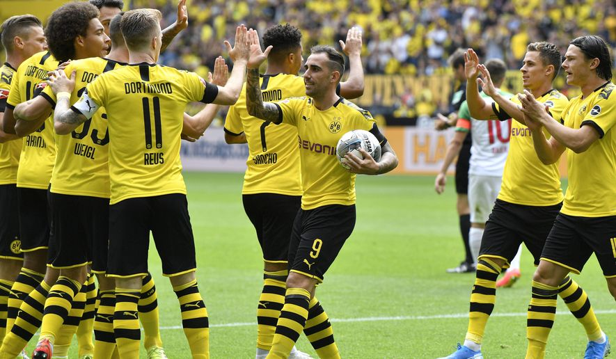 File---Picture taken Aug.17, 2019 shows Dortmund's Paco Alcacer holding the ball as he celebrates after scoring his side's first goal during the German Bundesliga soccer match between Borussia Dortmund and FC Augsburg at the Signal Iduna Park stadium in Dortmund, Germany. (AP Photo/Martin Meissner)
