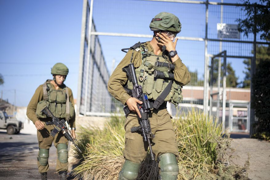Israeli soldiers secure the village of Avivim on the Israel-Lebanon border, Monday, Sept. 2, 2019. Hezbollah militants on Sunday fired a barrage of anti-tank missiles into Israel, prompting a reprisal of heavy Israeli artillery fire in a rare burst of fighting between the bitter enemies. (AP Photo/Ariel Schalit)