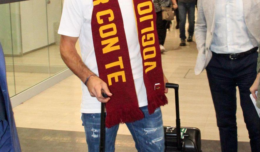New Roma player Henrikh Mkhitaryan arrives at Rome's Fiumicino international airport, Monday, Sept. 2, 2019.  (Telenews/ANSA via AP)