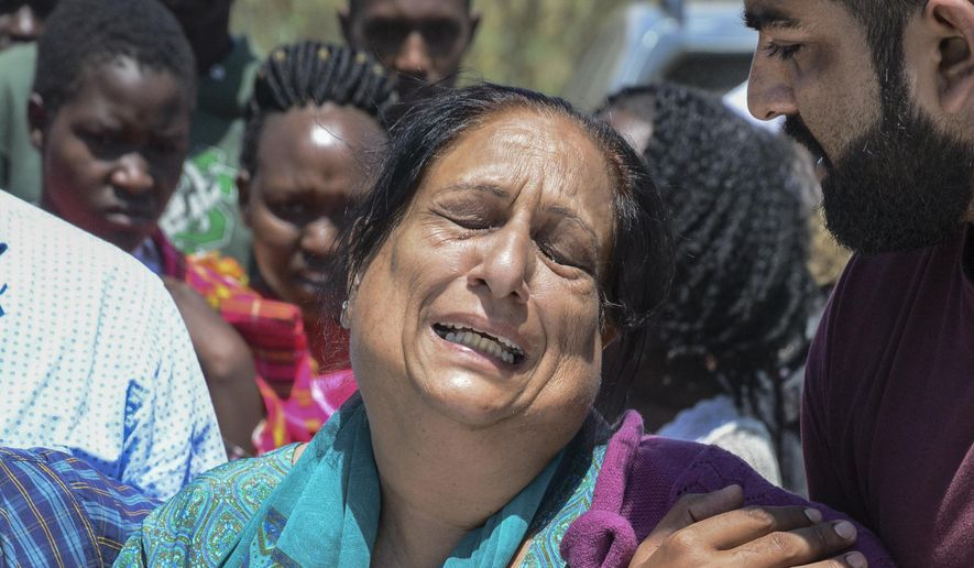 Relatives grieve as bodies of some of the victims are retrieved by rescuers, after a flash flood in Hell's Gate national park near Naivasha, Kenya Monday, Sept. 2, 2019. Kenyan authorities have suspended visits to the gorges of the park in the Rift Valley after the flash flood, which occurred Sunday evening, killed a number of tourists and their driver. (AP Photo)