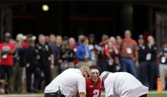 FILE - In this Sept. 8, 2018, file photo, trainers examine injured Nebraska quarterback Adrian Martinez (2) during the second half of an NCAA college football game against Colorado in Lincoln, Neb. Nebraska has circled this week's game against Colorado on the schedule, and not just because the teams are former Big Eight/Big 12 rivals. The Cornhuskers are looking to avenge last year's loss, when they squandered a second-half lead and the Buffaloes injured Adrian Martinez. (AP Photo/Nati Harnik, File)