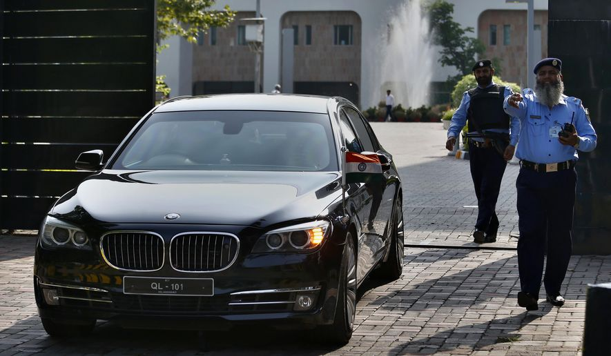 A vehicle carrying an Indian diplomat leaves the foreign ministry following a meeting with Kulbhushan Jadhav, an imprisoned Indian convicted of spying, in Islamabad, Pakistan, Monday, Sept. 2, 2019. Pakistan has granted rare consular access to Jadhav who faces the death penalty in a case that's been a source of friction between the nuclear-armed neighbors who have recently seen tensions between them escalate further over disputed Kashmir. (AP Photo/Anjum Naveed)
