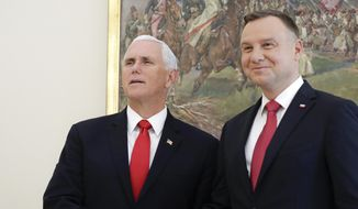 U.S. Vice President Mike Pence, left, shakes hands with Polish President Andrzej Duda during a meeting in Warsaw, Poland, Monday, Sept. 2, 2019. (AP Photo/Petr David Josek)