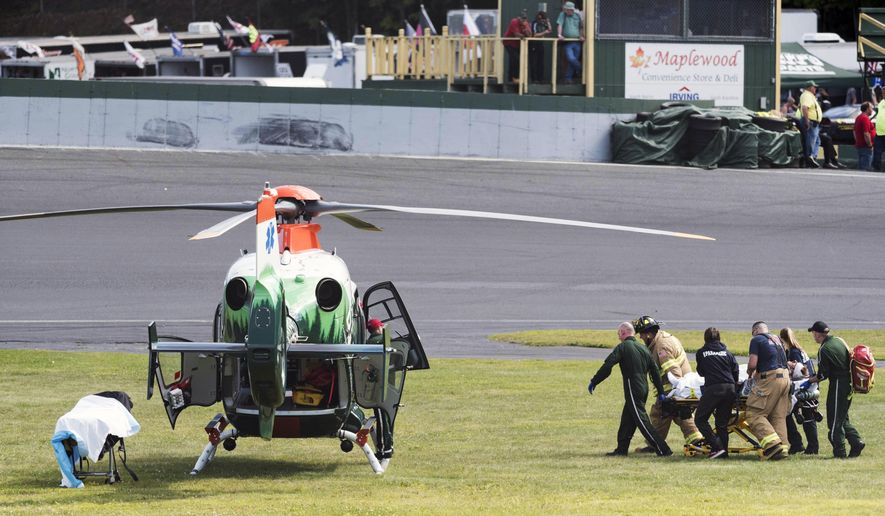 In this Sunday, Sept. 1, 2019, photo, a track official is transported on the infield to the Dartmouth-Hitchcock Advanced Response Team helicopter at Thunder Road on following an on-track accident in a qualifying race of the 41st Labor Day Classic auto race in Barre, Vermont. (Josh Kuckens/The Times Argus via AP)