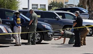 Officials continue to work the scene, Monday, Sept. 2, 2019, in Odessa, Texas, where teenager Leilah Hernandez was fatally shot at a car dealership during Saturday's shooting rampage. (AP Photo/Sue Ogrocki)