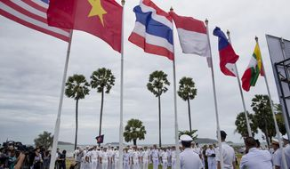Officers of the U.S. Navy and maritime forces of Association of Southeast Asian Nations (ASEAN) participate in the inauguration ceremony of ASEAN-U.S. Maritime Exercise in Sattahip, Thailand, Monday, Sep. 2, 2019. (AP Photo/Gemunu Amarasinghe)