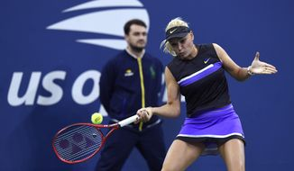 Donna Vekic, of Croatia, returns to Julia Goerges, of Germany, during the fourth round of the US Open tennis championships Monday, Sept. 2, 2019, in New York. (AP Photo/Sarah Stier)