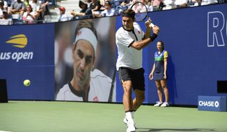 Roger Federer, of Switzerland, warms up prior to facing David Goffin, of Belgium, during the fourth round of the US Open tennis championships Sunday, Sept. 1, 2019, in New York. (AP Photo/Sarah Stier)