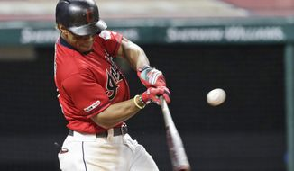 Cleveland Indians' Francisco Lindor hits an RBI-single in the seventh inning in a baseball game against the Chicago White Sox, Monday, Sept. 2, 2019, in Cleveland. Yu Chang scored on the play. (AP Photo/Tony Dejak)