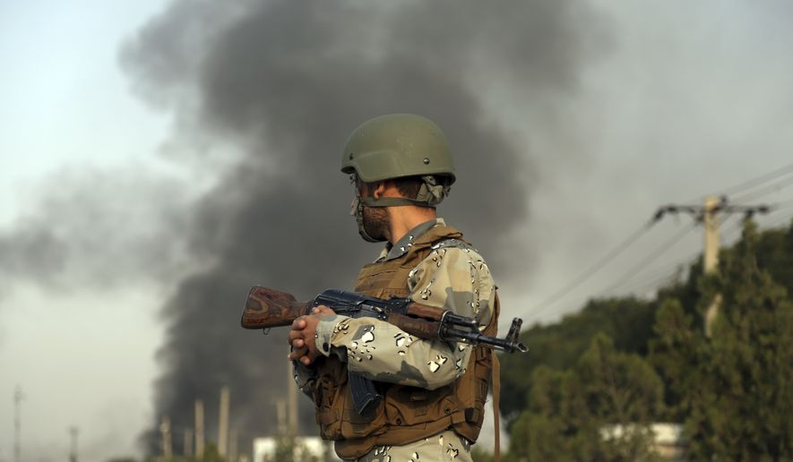 Smoke rises as angry Kabul residents set fire to part of the Green Village compound that has been attacked frequently, a day after a Taliban suicide attack in Kabul, Tuesday, Sept. 3, 2019. An interior ministry spokesman said some hundreds of foreigners were rescued after the attack targeted the compound, which houses several international organizations and guesthouses. (AP Photo/Rahmat Gul)