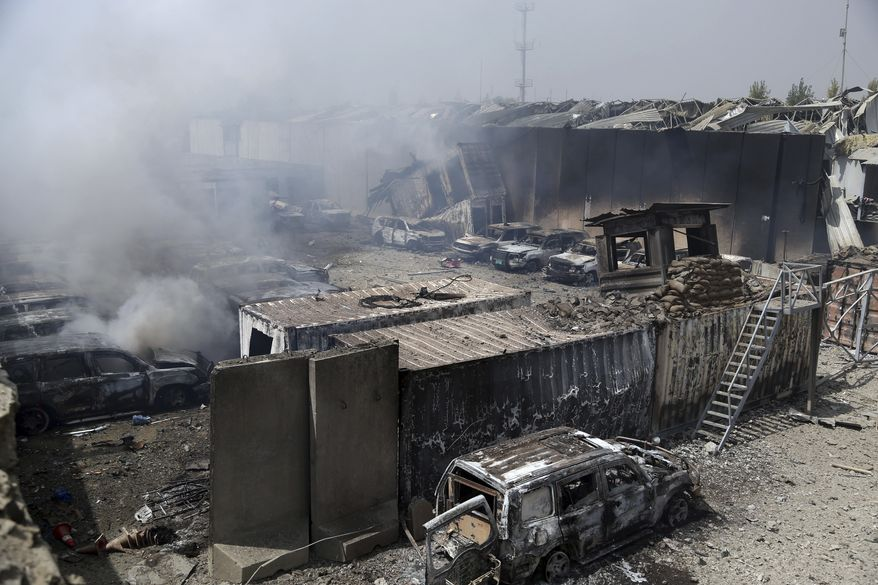 Burning cars are seen inside the Green Village after Monday's suicide bomb attack in Kabul, Afghanistan, Tuesday, Sept. 3, 2019. The attack occurred late Monday near the Green Village, home to several international organizations and guesthouses. (AP Photo/Rahmat Gul)