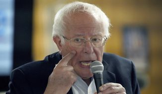 Democratic presidential candidate Sen. Bernie Sanders, I-Vt talks about the inclusion of vision care in his Medicare for all plan as he campaigns at the Circle 9 Ranch Campground Bingo Hall, Tuesday, Sept. 3, 2019, in Epsom, N.H. (AP Photo/Mary Schwalm)