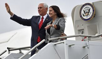 US Vice President Mike Pence and his wife Karen Pence arrive at Shannon airport from Dublin during an official visit to Ireland, Tuesday Sept. 3, 2019. Pence said Tuesday during a visit with Irish Prime Minister Leo Varadkar in Dublin on Tuesday that the United States supports Britain's decision to leave the European Union and wants to see negotiations succeed. (Jacob King/PA via AP)