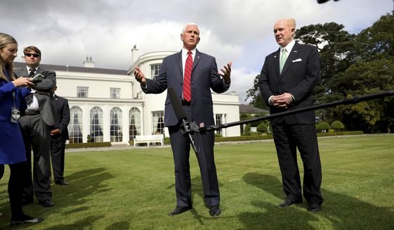 US Vice President Mike Pence, left, and US Ambassador to Ireland Edward Crawford speak to the media at the ambassador's residence in Phoenix park, Dublin, Ireland, Tuesday, Sept. 3, 2019. The Vice President is currently in Ireland for a two day visit. (AP Photo/Peter Morrison)