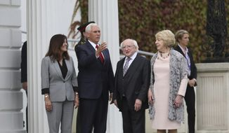 US Vice President Mike Pence and wife Karen Pence, left, meet with Irish President Michael D Higgins and his wife Sabrina at Aras an Uachtarain the official residence of the Irish President , Dublin, Ireland, Tuesday, Sept. 3, 2019. The Vice President is currently in Ireland for a two day visit. (AP Photo/Peter Morrison)