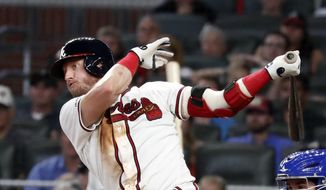 Atlanta Braves' Josh Donaldson follows through on a two-run double in the fifth inning of the team's baseball game against the Toronto Blue Jays on Tuesday, Sept. 3, 2019, in Atlanta. (AP Photo/John Bazemore)