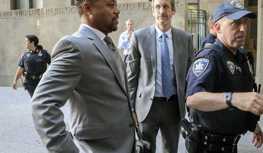 Cuba Gooding, Jr., left, arrives at court to face a groping allegation charge, Tuesday Sept. 3, 2019, in New York. (AP Photo/Bebeto Matthews)