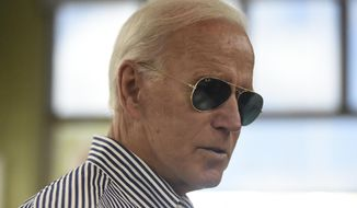 Democratic presidential candidate former Vice President Joe Biden pays for his order at a Krispy Kreme following a campaign town hall on Wednesday, Aug. 28, 2019, in Spartanburg, S.C. (AP Photo/Meg Kinnard) ** FILE **