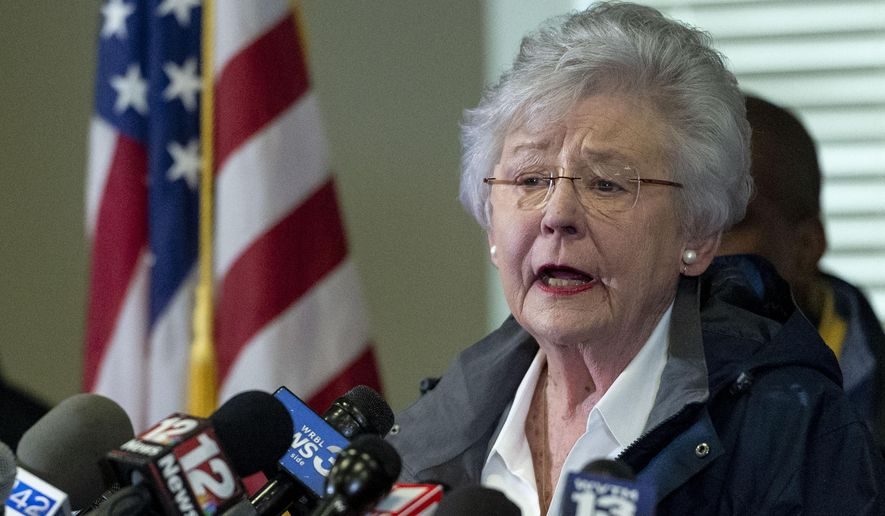 """FILE - In this March 4, 2019 file photo Alabama Gov. Kay Ivey speaks at a news conference in Beauregard, Ala. Alabama Gov. Kay Ivey is apologizing after a radio interview described her wearing blackface during a college skit in the 1960s. Ivey issued a statement Thursday, Aug. 29, 2019 saying that she does not remember the sketch or ever wearing blackface but wanted to """"offer my heartfelt apologies for the pain and embarrassment this causes."""" (AP Photo/Vasha Hunt, File)"""