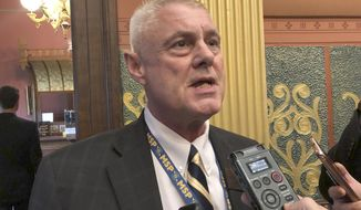 State Rep. Larry Inman, R-Williamsburg, speaks with reporters on Tuesday, Sept. 3, 2019, in the House chamber in Lansing, Mich. Inman who recently completed treatment for an addiction to painkillers, returned to vote for the first time since May, when he was charged with trading votes for campaign money. (AP Photo/David Eggert)