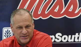 FILE - In this Aug. 1, 2019, file photo, Mississippi offensive coordinator Rich Rodriguez talks during Mississippi's Media Day at the Manning Center in Oxford, Miss. The arrival of new offensive coordinator Rich Rodriguez and the return of 1,000-yard rusher Scottie Phillips raised hope that Mississippi could have a potent rushing attack this year, but the Rebels gained less than 2 1/2 yards per carry in a season-opening loss to Memphis. Mississippi believes the lessons it learned can help boost the running game the rest of the year. (AP Photo/Thomas Graning, File)