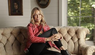 """In this Aug. 19, 2019, photo, Sheryl Crow poses in Nashville, Tenn. to promote her latest album, """"Threads."""" (AP Photo/Mark Humphrey)"""