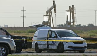 FILE - In this Sept. 1, 2019, file photo, a U.S. Mail vehicle, right, which was involved in Saturday's shooting, sits outside the Cinergy entertainment center in Odessa, Texas. The mass shooting in West Texas spread terror over more than 10 miles (16 kilometers) as the gunman, Seth Aaron Ator, fired from behind the wheel of a car. Ator zigzagged through Midland and Odessa, two closely intertwined cities now brought closer by tragedy. (AP Photo/Sue Ogrocki, File)