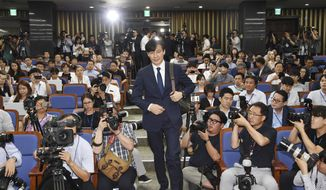In this Sept. 2, 2019 photo, Cho Kuk, a nominee for South Korea's Justice Minister, arrives for a news conference at National Assembly in Seoul, South Korea. South Korean reporters have grilled President Moon Jae-in's nominee as justice minister for 11 hours over suspected ethical lapses surrounding his family that have triggered an intense political row and cut into Moon's popularity ratings. (Kim Ju-hyung/Yonhap via AP)