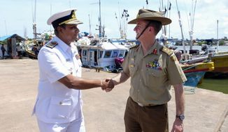 Maj. Gen. Craig Furini, head of Operation Sovereign Borders, right, shakes hands with Director General Operations Sri Lanka Navy Rear Admiral Niraja Atigala  after addressing a press conference at Fishery Harbour, Negambo, Sri Lanka, Tuesday, Sept. 3, 2019. The Australian general in charge of combating illegal migration says there's been an increase in the number of Sri Lankans seeking to enter Australia illegally by boat in recent months. (AP Photo/Amila Gamage)
