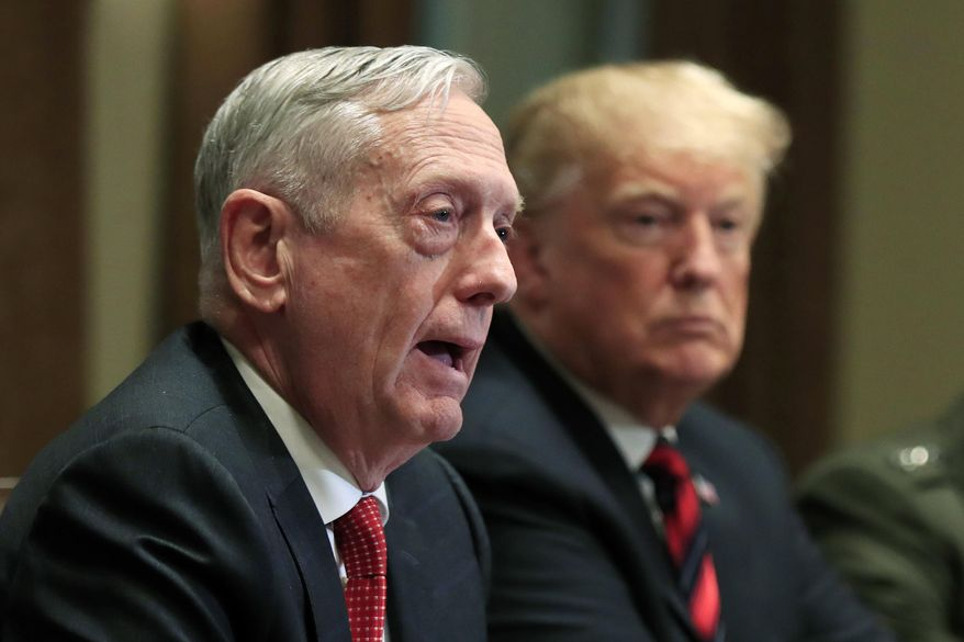 FILE - In this Oct. 23, 2018 file photo, Defense Secretary Jim Mattis speaks beside President Donald Trump, during a briefing with senior military leaders in the Cabinet Room at the White House in Washington. In Trump's America, is anyone listening to the conservative wise men who damn him with faint, coded criticism? (AP Photo/Manuel Balce Ceneta, File)