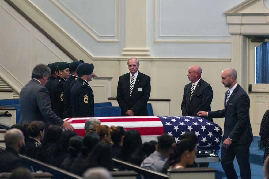 Funeral services for U.S. Army Green Beret Master Sgt. Luis DeLeon-Figueroa, who was killed in action in Afghanistan on Aug. 21, are held at Bethany Assembly of God Church in Agawam, Mass. Tuesday, Sept. 3, 2019. (Hoang 'Leon' Nguyen / The Republican via AP)