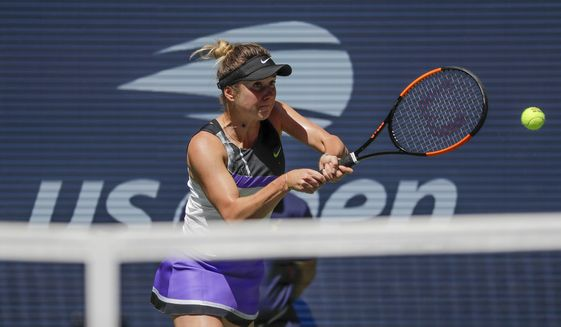 Elina Svitolina, of Ukraine, returns a shot to Johanna Konta, of the United Kingdom, during the quarterfinals of the US Open tennis championships Tuesday, Sept. 3, 2019, in New York. (AP Photo/Frank Franklin II)