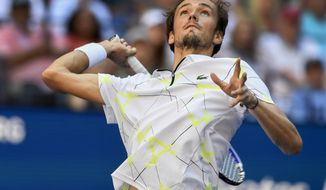 Daniil Medvedev, of Russia, serves to Stan Wawrinka, of Switzerland, during the quarterfinals of the US Open tennis championships Tuesday, Sept. 3, 2019, in New York. (AP Photo/Sarah Stier)