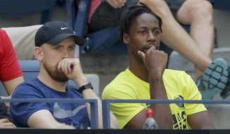 Gael Monfils, of France, right, watches a match between Elina Svitolina, of Ukraine, and Johanna Konta, of the United Kingdom, during the quarterfinals of the US Open tennis championships Tuesday, Sept. 3, 2019, in New York. (AP Photo/Frank Franklin II)
