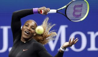 Serena Williams, of the United States, returns a shot to Qiang Wang, of China, during the quarterfinals of the U.S. Open tennis tournament Tuesday, Sept. 3, 2019, in New York. (AP Photo/Seth Wenig)