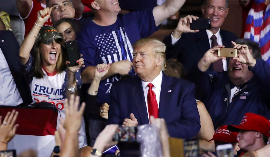 In this file photo, fans cheer as President Trump arrives at a rally in New Hampshire. On Feb. 7, 2020, Mr. Trump said in a tweet that so long as he's president, both Iowa and New Hampshire will retain their first-in-the-nation bragging rights for caucuses and primaries, respectively. (Associated Press)