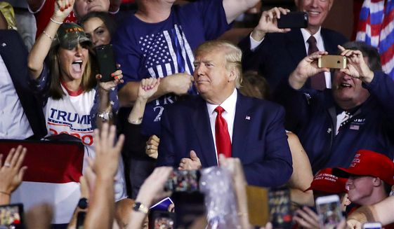 Fans cheer as President Trump arrives at a rally in New Hampshire. The GOP has a chance to reshape the political landscape in 2020. (Associated Press)
