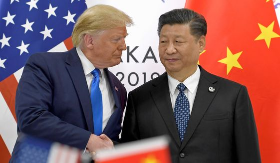 When U.S. and Chinese officials met last month in Beijing, the talks hit an impasse with Beijing officials digging in their heels in refusing to acknowledge past illicit activities. (Associated Press)