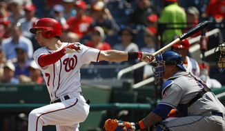 Washington Nationals' Trea Turner singles in front of New York Mets catcher Wilson Ramos in the second inning of a baseball game, Wednesday, Sept. 4, 2019, in Washington. Gerardo Parra scored on the play. (AP Photo/Patrick Semansky)