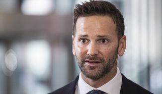 FILE - In this March 6, 2019, file photo, former U.S. Rep. Aaron Schock, R-Ill., speaks to reporters at the Dirksen Federal Courthouse in Chicago. Corruption charges against Schock have been dismissed under a deal struck with prosecutors in March. U.S. District Court Judge Matthew Kennelly ordered an indictment against Schock dismissed on Wednesday. (Ashlee Rezin/Chicago Sun-Times via AP, File)