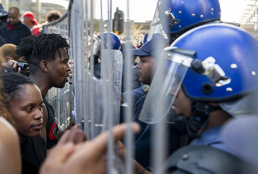 Demonstrators confront police in an attempt to gain entry to where the World Economic Forum on Africa is being held in Cape Town, South Africa, Wednesday, Sept. 4, 2019. The protesters are demanding that the government crack down on gender-based violence, following a week of brutal murders of young South African women that has shaken the nation. (AP Photo)