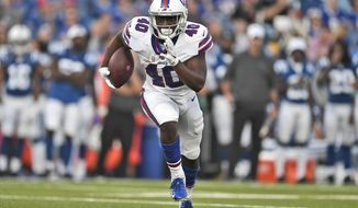 FILE - In this Aug. 8, 2019, file photo, Buffalo Bills' Devin Singletary runs the ball during the first half of an NFL preseason football game against the Indianapolis Colts, in Orchard Park, N.Y. Singletary's encouraging performance through training camp and the preseason led to the Buffalo Bills' decision to release LeSean McCoy last weekend. Singletary will open the season at the New York Jets this weekend splitting the starting job with veteran Frank Gore.  (AP Photo/Adrian Kraus, File)