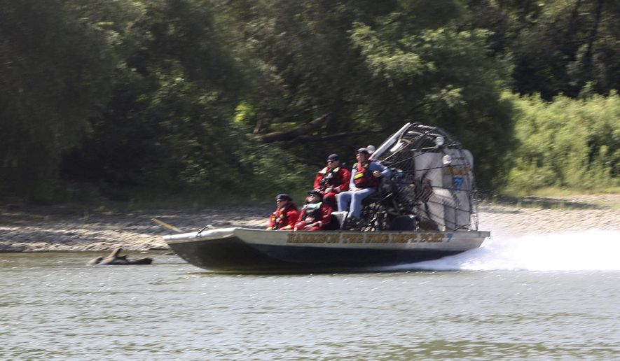 In this Tuesday, Sept. 3, 2019, photo an air boat from Harrison Township Fire Department makes its way up river as part of the search effort to recover the final victim of the boating accident near Martinsville, Ind. Authorities will continue searching for a man missing since a Labor Day boating accident on a central Indiana river that left several people dead, including a 6-year-old boy. (Keith Rhoades/The Herald-Times via AP)