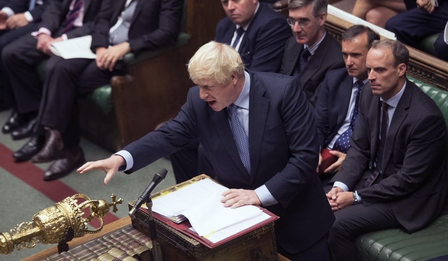 In this handout photo provided by the House of Commons, Britain's Prime Minister Boris Johnson gestures during his first Prime Minister's Questions, in the House of Commons in London, Wednesday, Sept. 4, 2019. Britain's Parliament is facing a second straight day of political turmoil as lawmakers fought Prime Minister Boris Johnson's plan to deliver Brexit in less than two months, come what may. Johnson is threatening to dissolve the House of Commons and hold a national election that he hopes might produce a less fractious crop of legislators. (Jessica Taylor/House of Commons via AP)