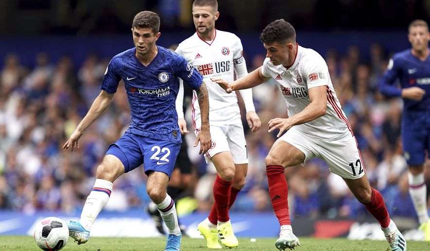 Chelsea's Christian Pulisic, left, and Sheffield United's John Egan battle for the ball during their English Premier League soccer match at Stamford Bridge, London, Saturday, Aug. 31, 2019. (John Walton/PA via AP)