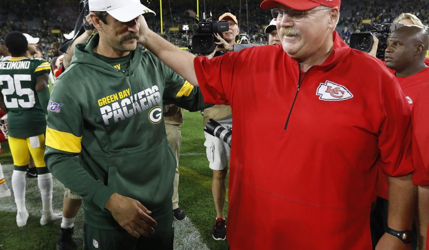 Green Bay Packers' Aaron Rodgers talks to Kansas City Chiefs head coach Andy Reid after a preseason NFL football game Thursday, Aug. 29, 2019, in Green Bay, Wis. (AP Photo/Mike Roemer)